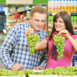 Family at fruit food shopping in supermarket — Stock Photo #31182609