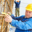Stock Photo: Construction worker making reinforcement