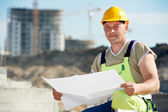 Engineer builder at construction site with draft — Stock Photo