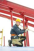 Builder worker assembling metal construction — Stock Photo