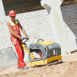 Worker with compaction machine — Stock Photo