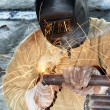 Stock Photo: Worker welding with electric arc electrode