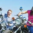 Young couple outdoors on bikes — Stock Photo #31326965