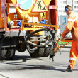Asphalt patching roadworks — Stock Photo #31328799