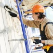 Facade builder plasterer at work — Stock Photo #31577623