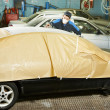 Repairman sanding car roof — Stock Photo