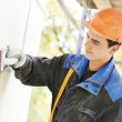 Facade builder plasterer at work — Stock Photo #31578565