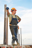 Building workerat pouring concrete — Stock Photo