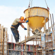 Building workers pouring concrete with barrel — Stock Photo #31583143