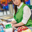 Shopping. Cashdesk worker in supermarket — Stock Photo