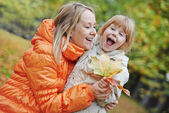Happy mother and daughter in autumn — Stok fotoğraf