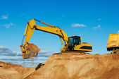 Excavator loading tipper dumper — Stock Photo