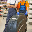 Cleaning team with machine in store — Foto de Stock