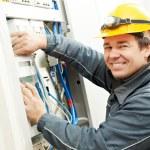 Electrician installing energy saving meter — Stock Photo #32581833