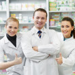 Stock Photo: Pharmacy chemist group in drugstore
