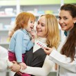 Pharmacy chemist, mother and child in drugstore — Stock Photo #32581941