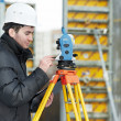 Stock Photo: Surveyor works with theodolite
