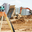 Stock Photo: Surveyor equipment level at construction site