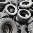 Stock Photo: Used car tyres garbage for recycling