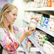 Woman at milk dairy shopping — Stock Photo