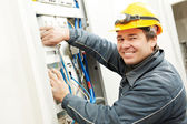 Electrician installing energy saving meter — Stock Photo