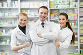 Pharmacy chemist group in drugstore — Stock Photo