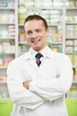Man pharmacy chemist in drugstore — Stock Photo