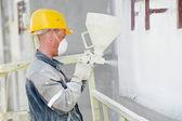 Builder facade plasterer worker — Stock Photo