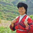 Smiling chinese minority womYao — Stock Photo #32721115