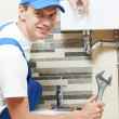 Young smiling plumber man worker — Stock Photo
