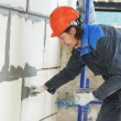 Facade builder plasterer at work — Stock Photo #32738089