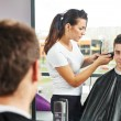 Male hairdresser at work — Stock Photo #33303653