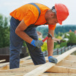Carpenter works on roof — Stock Photo #35825015
