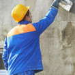 Worker at plastering facade work — Stockfoto