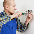Electrician installing wall outlets — Stock Photo
