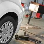 Automobile car headlight checkup — Stock Photo