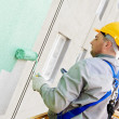 Builder facade painter at work — Stockfoto