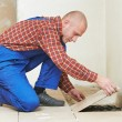 Tiler at home floor tiling renovation work — Stock Photo