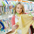 Young pregnant woman at clothes shop — Stock Photo