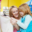 Woman and little girl shopping clothes — Stock Photo #35983373