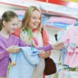 Woman and little girl shopping clothes — Stock Photo #35983433