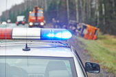 Police car with a flasher at lorry crash — Stock Photo