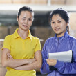 Stock Photo: Two chinese female workers in warehouse