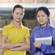 Two chinese female workers in warehouse — Stock Photo