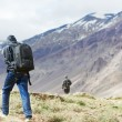 Three tourist hiking in india mountains — Stock Photo #36599479