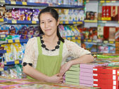 Chinese woman seller in shop — Stock Photo
