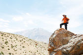 Tourist hiker hands up on mountain top — Stock Photo