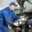 Auto mechanic at repair work — Foto Stock