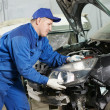 Auto mechanic at repair work — 图库照片