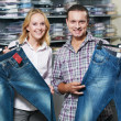 Young couple at clothes shopping — Stock Photo #36833785